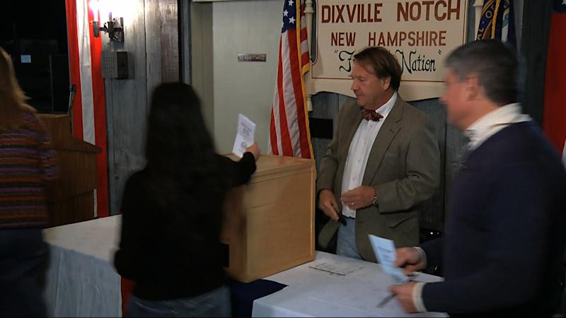 In this still frame made from video, voters drop their ballots in the ballot box after casting their votes in Dixville Notch, N.H., Tuesday, Nov. 6, 2012, as they cast the first Election Day votes in the nation. After 43 seconds of voting, President Barack Obama and Republican Mitt Romney each had 5 votes in Dixville Notch. (AP Photo/APTN)
