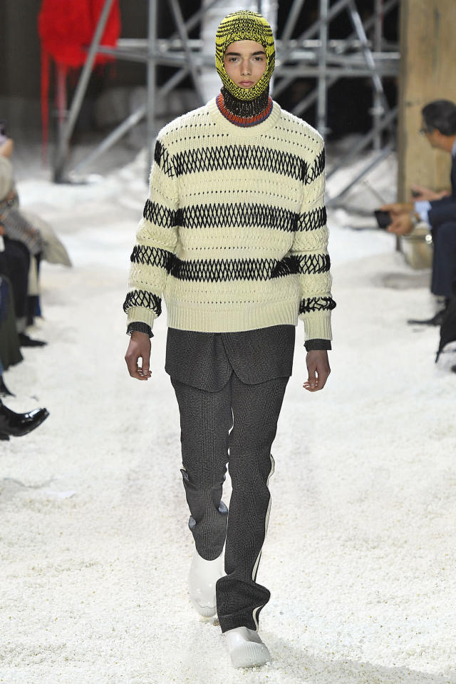 <p>A model wears a balaclava, a striped sweater, and trousers at the Calvin Klein fall 2018 show. (Photo: Getty Images) </p>