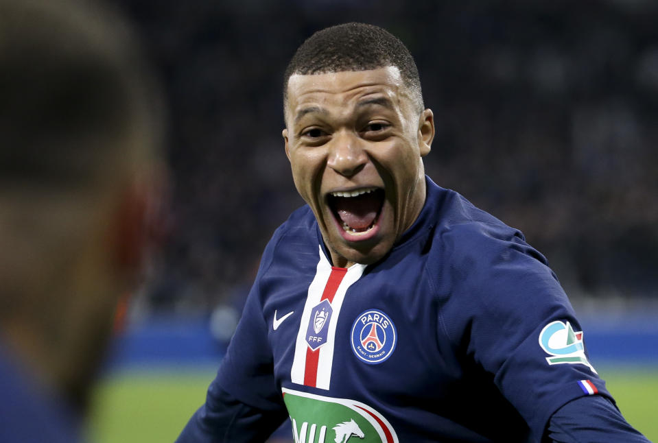 LYON, FRANCE - MARCH 4: Kylian Mbappe of PSG celebrates his third goal with Neymar Jr during the French Cup semifinal match between Olympique Lyonnais (OL) and Paris Saint-Germain (PSG) at Groupama Stadium on March 4, 2020 in Decines near Lyon, France. (Photo by Jean Catuffe/Getty Images)