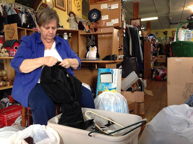 21 2013 Photo Cleda Turner Director Of The Owsley County Outreach Folds Clothes At Thrift Store In Booneville Ky A Drop Federal Food Assistance