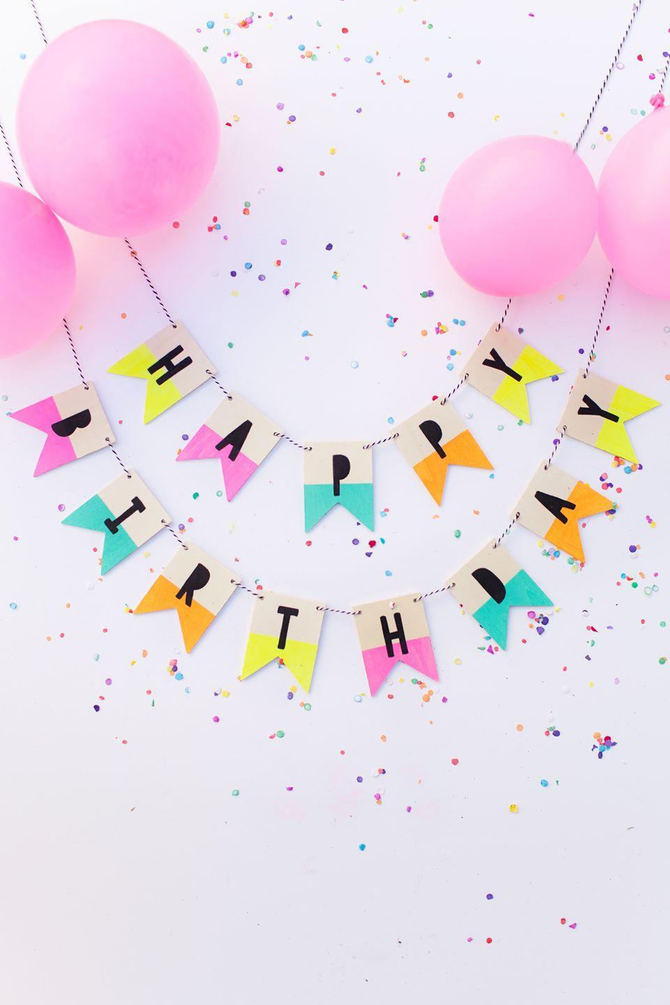 """<p>Rather than buying a banner from the store, you can make your own happy birthday sign with twine, acrylic paint, and thin wood slabs. </p><p><strong><em><a href=""""https://tellloveandparty.com/2015/06/wood-birthday-banner.html"""" rel=""""nofollow noopener"""" target=""""_blank"""" data-ylk=""""slk:Get the tutorial at Tell Love and Party"""" class=""""link rapid-noclick-resp"""">Get the tutorial at Tell Love and Party</a>. </em></strong></p><p><a class=""""link rapid-noclick-resp"""" href=""""https://www.amazon.com/Unfinished-Painting-Supplies-Engraving-Decorations/dp/B08BLFMFGB?tag=syn-yahoo-20&ascsubtag=%5Bartid%7C10070.g.37055923%5Bsrc%7Cyahoo-us"""" rel=""""nofollow noopener"""" target=""""_blank"""" data-ylk=""""slk:SHOP WOOD BANNER PIECES"""">SHOP WOOD BANNER PIECES</a></p>"""
