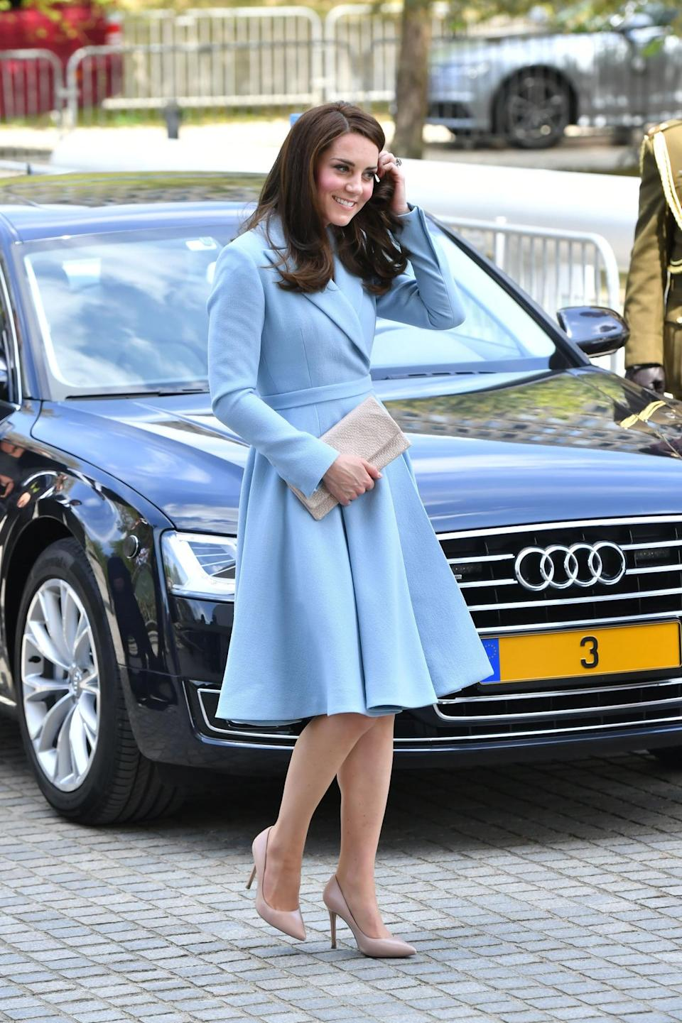 <p>Kate embarked on a solo trip to Luxembourg as part of Britiain's Brexit strategy. The Duchess chose a pale blue Emilia Wickstead coat dress featuring a pleated skirt and large collar. As usual, she teamed the look with nude satin heels and a matching clutch. </p><p><i>[Photo: PA]</i></p>