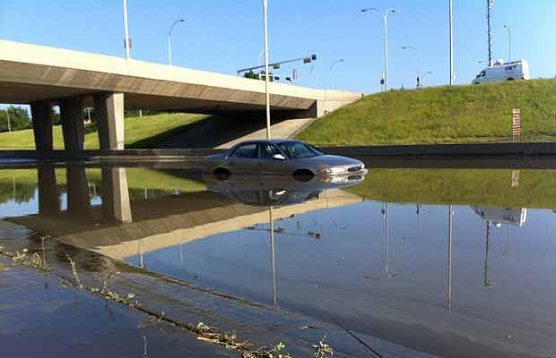 A car sits on Whitemud Drive following a storm that pounded south Edmonton with hail and heavy rain on July 12, 2012.