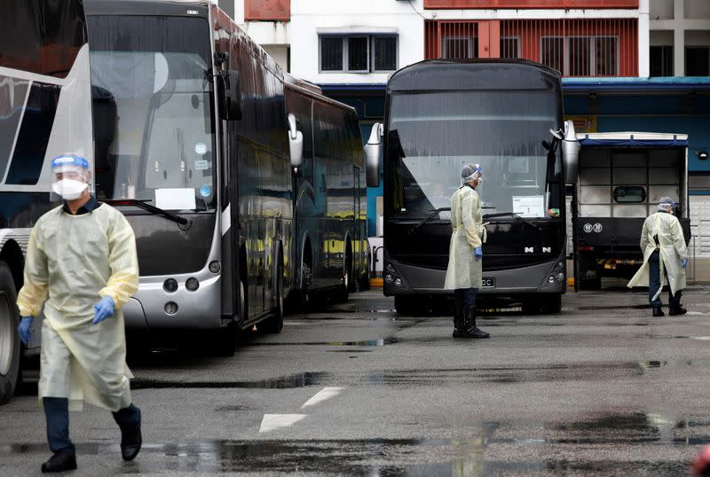 Buses stand by to transport migrant workers to a government quarantine facility after workers were tested positive for the coronavirus disease (COVID-19) at Westlite Woodlands dormitory in Singapore