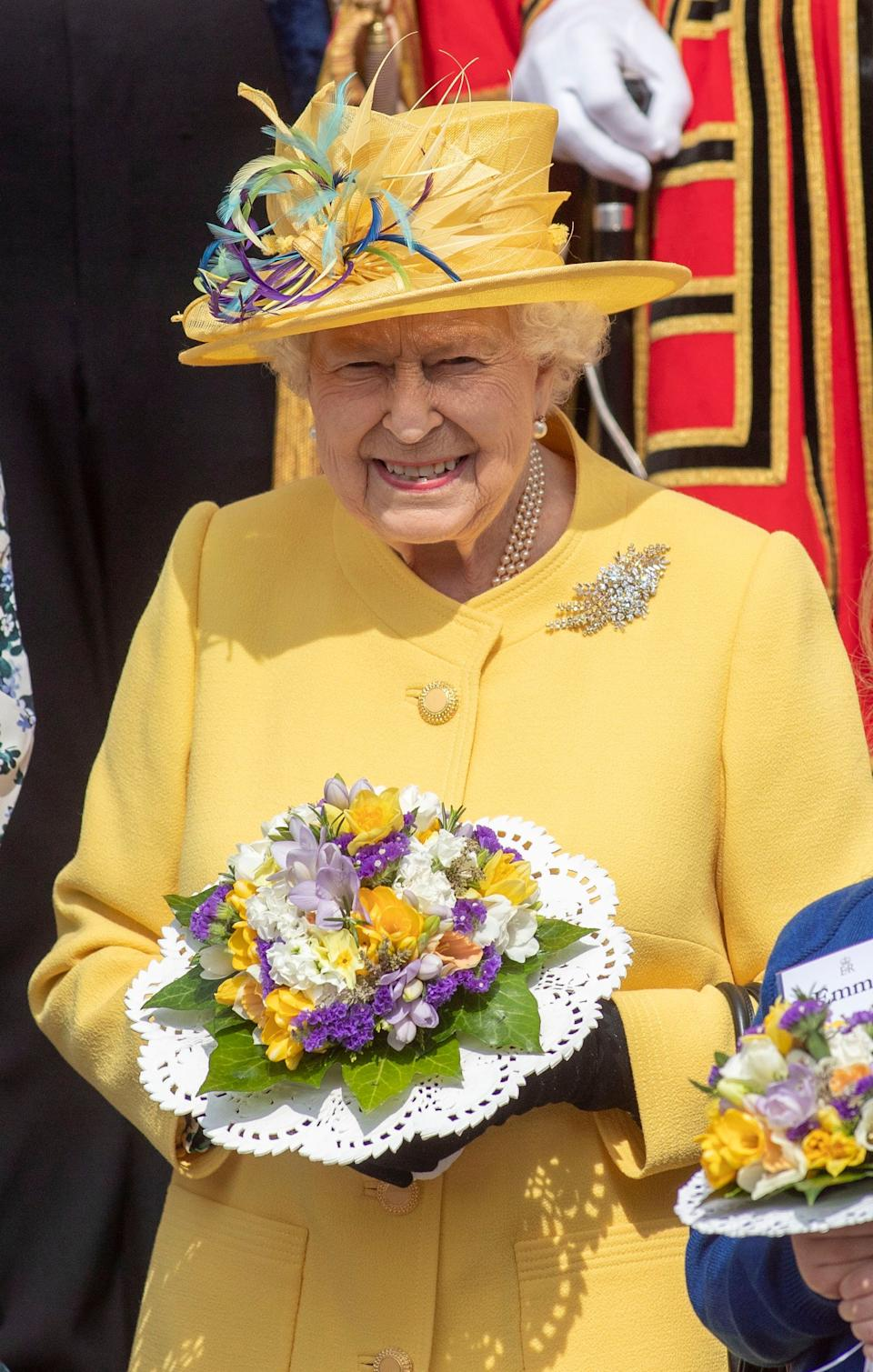 The Queen wore a buttercup yellow coat for the Maundy Thursday service [Photo: PA]