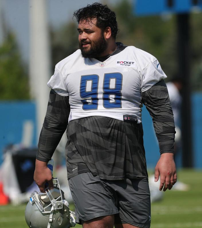Detroit Lions nose tackle John Penisini walks off the field after  training camp at the Allen Park facility Wednesday, July 28, 2021.