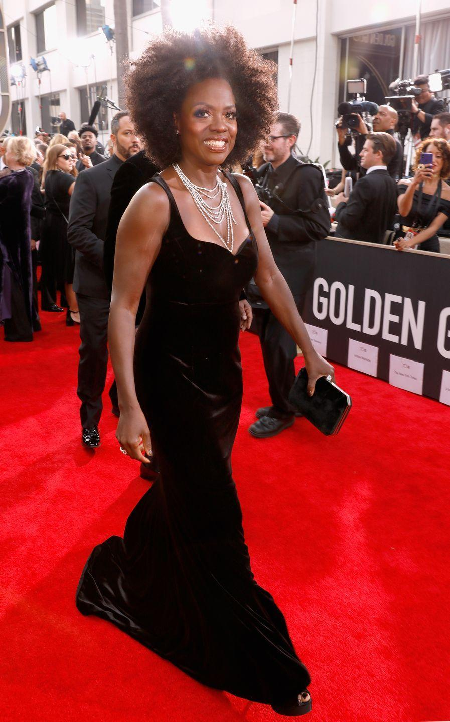 <p>The <em>How to Get Away with Murder</em> actress hit the 2018 red carpet in a classic, body-hugging, black velvet look.</p>