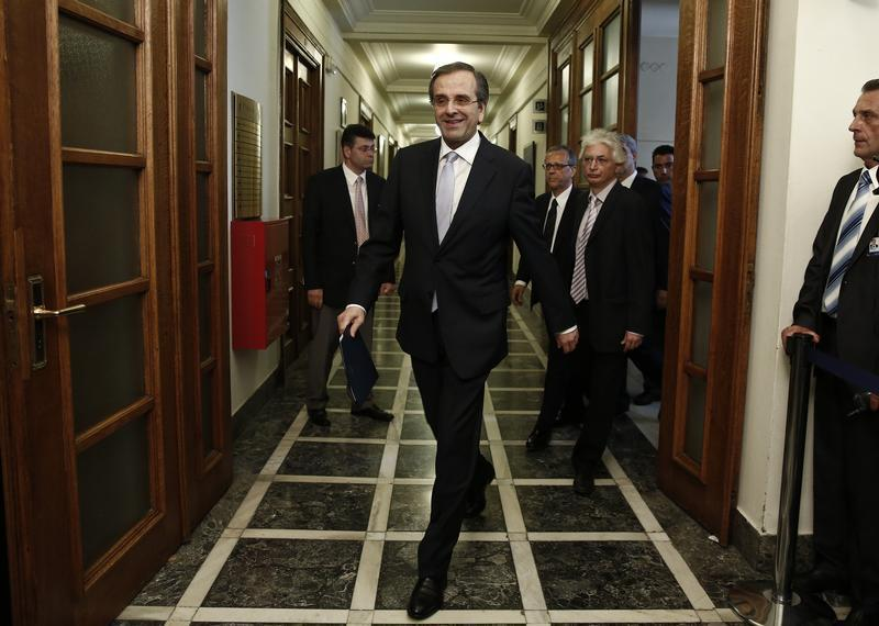 Greece's Prime Minister Samaras arrives for a cabinet meeting in Athens
