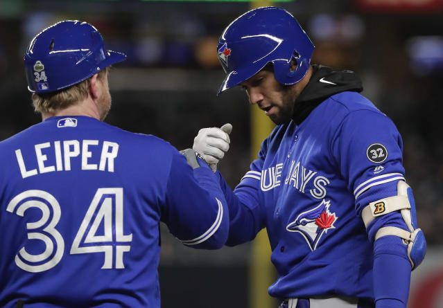 Toronto Blue Jays' Lourdes Gurriel Jr., right, is congratulated by first base coach Tim Leiper (34) after driving in a run on a base hit against the New York Yankees during the fifth inning of a baseball game, Friday, April 20, 2018, in New York. (AP Photo/Julie Jacobson)