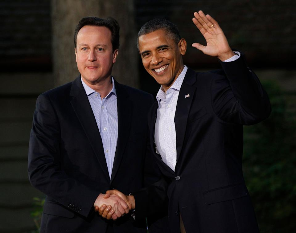 President Barack Obama shakes hands with Britain's Prime Minister David Cameron on arrival for the G8 Summit Friday, May 18, 2012 at Camp David, Maryland.