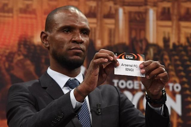 Former French international midfielder Eric Abidal picks Arsenal in the draw for the last 16 of the Europa League, pairing them with AC Milan (AFP Photo/jean-guy PYTHON)