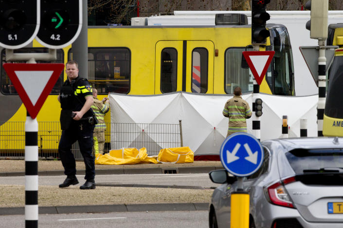 Rescue workers install a screen on the spot where a body was covered with a white blanket following a shooting in Utrecht, Netherlands, Monday, March 18, 2019. (Photo: Peter Dejong/AP)
