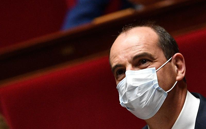 Prime Minister Jean Castex wearing a face mask attends a session of questions to the Government at the French National Assembly in Paris on July 8 - AFP