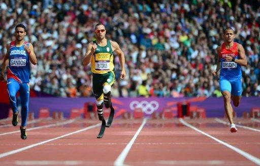 Dominican Republic's Luguelin Santos (left), South Africa's Oscar Pistorius (centre) and Russia's Maksim Dyldin compete in the men's 400m heats at the London 2012 Olympic Games