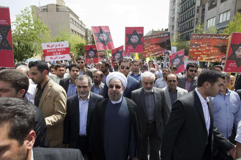 Iranian President elect Hasan Rouhani, center with white turban, attends Al-Quds (Jerusalem) Day annual pro-Palestinian rally, in Tehran, Iran, Friday, Aug. 2, 2013. Iran's semiofficial ISNA news agency says it misquoted the country's president-elect Hasan Rouhani. The remarks, made during an annual pro-Palestinian rally, echoed longstanding views of other Iranian leaders and threatened to tarnish his image in the West as a voice of moderation in Iranian affairs.(AP Photo)