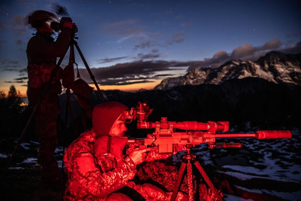 A German Special Forces Sniper team engage an elevated target at night