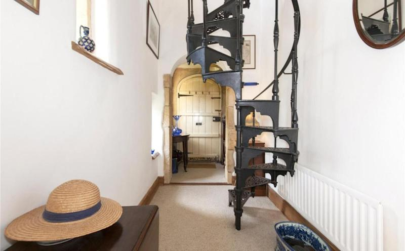 A wrought iron staircase leading up to the second floor of the building. (Savills)