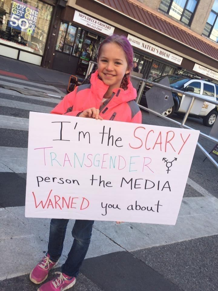 """In February, this image of Rebekah holding this sign at a trans rights rally <a href=""""http://www.huffingtonpost.com/entry/trans-girls-sign_us_58b5a151e4b0780bac2d8b72"""">went viral</a>. (Jamie Bruesehoff)"""