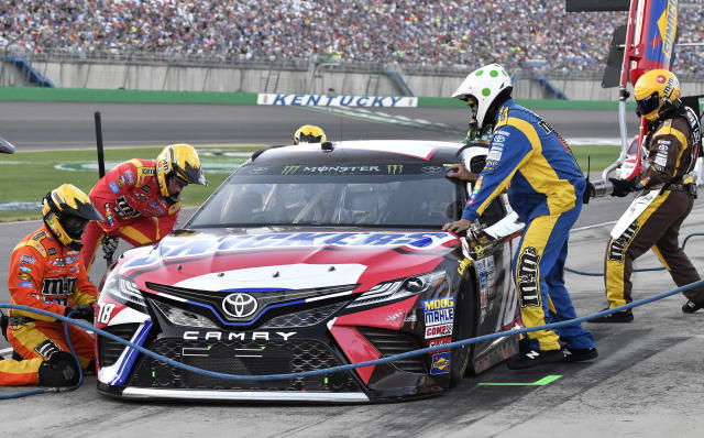 "<a class=""link rapid-noclick-resp"" href=""/nascar/sprint/drivers/947/"" data-ylk=""slk:Kyle Busch"">Kyle Busch</a> comes in for a pit stop during the NASCAR Cup auto race at Kentucky Speedway, Saturday, July 8, 2017, in Sparta, Ky. (AP Photo/Timothy D. Easley)"