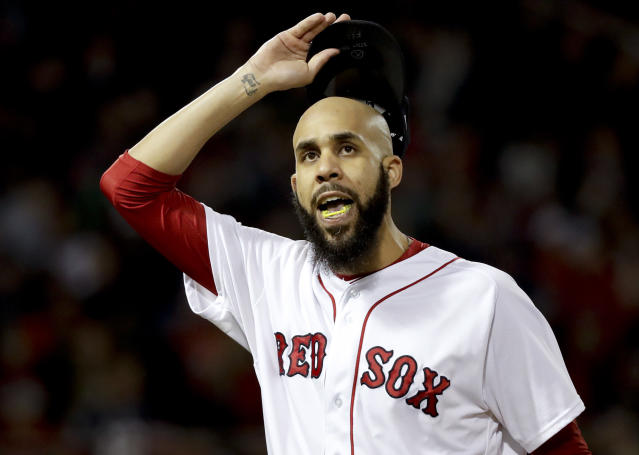 Boston Red Sox starting pitcher David Price reacts after giving up two runs to the Houston Astros during the second inning in Game 2 of a baseball American League Championship Series on Sunday, Oct. 14, 2018, in Boston. (AP Photo/David J. Phillip)