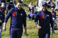 Team USA's Patrick Cantlay and Team USA's Xander Schauffele smile after winning the hole during a foursomes match the Ryder Cup at the Whistling Straits Golf Course Saturday, Sept. 25, 2021, in Sheboygan, Wis. (AP Photo/Ashley Landis)