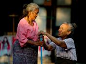 Two old friends in Myanmar. [Photo: SWNS]