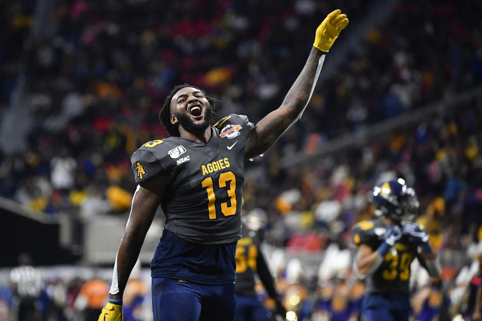 North Carolina A&T wide receiver Elijah Bell comes off the field celebrating after the first half of the Celebration Bowl NCAA college football game against Alcorn State, Saturday, Dec. 21, 2019, in Atlanta. North Carolina A&T won 64-44. (John Amis/Atlanta Journal-Constitution via AP)