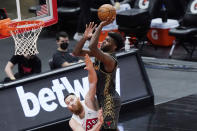 Chicago Bulls forward Patrick Williams, right, shoots against Toronto Raptors center Aron Baynes during the second half of an NBA basketball game in Chicago, Sunday, March 14, 2021. (AP Photo/Nam Y. Huh)