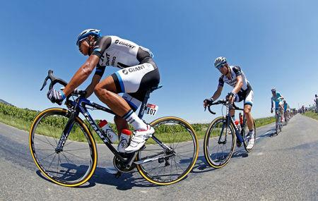 FILE PHOTO: Giant-Shimano team rider Ji Cheng of China leads the pack of riders during the 185.5-km 12th stage of the Tour de France cycling race between Bourg-en-Bresse and Saint-Etienne