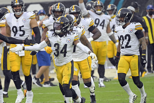 Pittsburgh Steelers safety Terrell Edmunds (34) celebrates with teammates after he intercepted a Jacksonville Jaguars pass during the second half of an NFL football game, Sunday, Nov. 22, 2020, in Jacksonville, Fla. (AP Photo/Phelan M. Ebenhack)