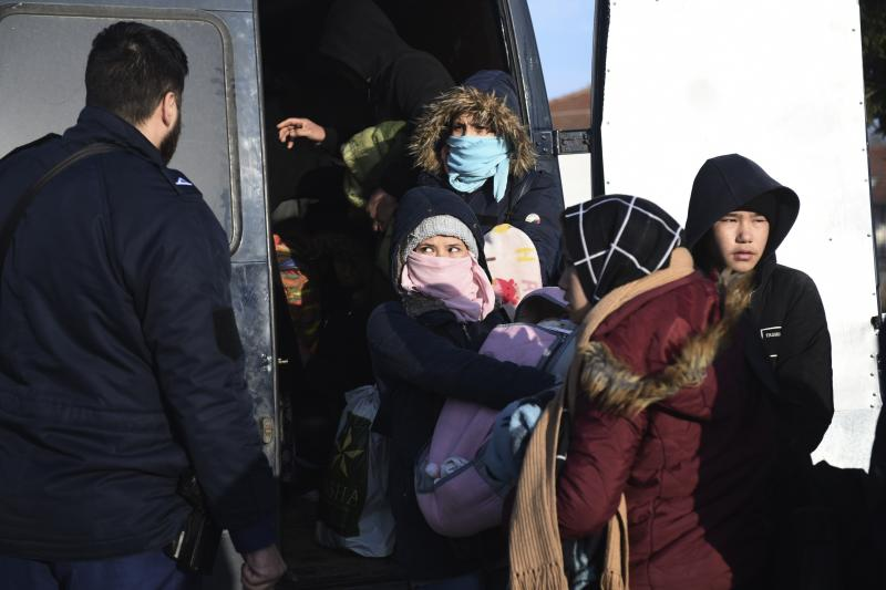 Migrants detain by Greek authorities in the village of Thourio near the Greek-Turkish border on Sunday, March 1, 2020. Turkey's President Recep Tayyip Erdogan said his country's borders with Europe were open Saturday, making good on a longstanding threat to let refugees into the continent as thousands of migrants gathered at the frontier with Greece. (AP Photo/Giannis Papanikos)