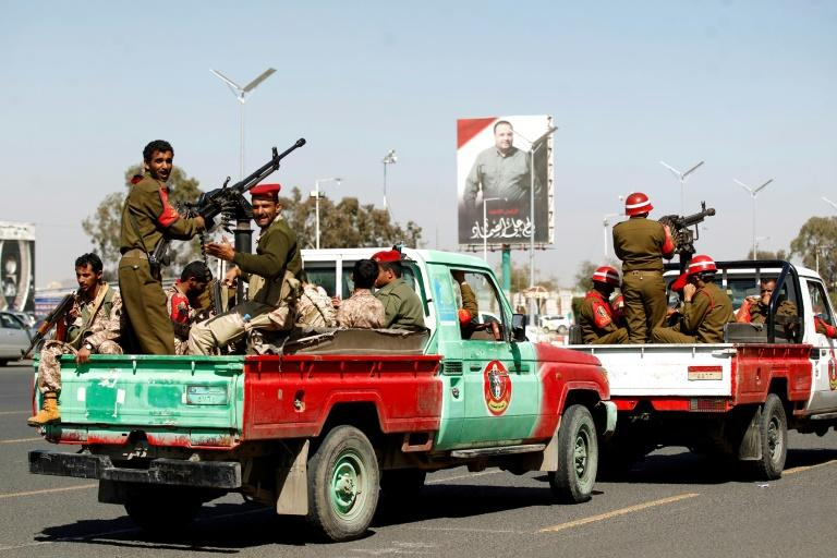 Members of Yemen's Iran-backed Huthi rebels parade in the streets of the capital Sanaa on January 8