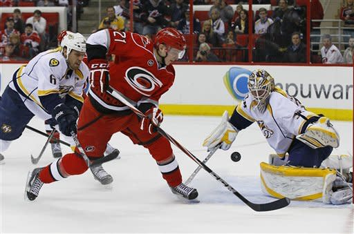 Carolina Hurricanes' Drayson Bowman (21) shoots as Nashville Predators goalie Anders Lindback, of Sweden, blocks while Shea Weber (6) defends during the second period of an NHL hockey game in Raleigh, N.C., Tuesday, Feb. 28, 2012. (AP Photo/Gerry Broome)