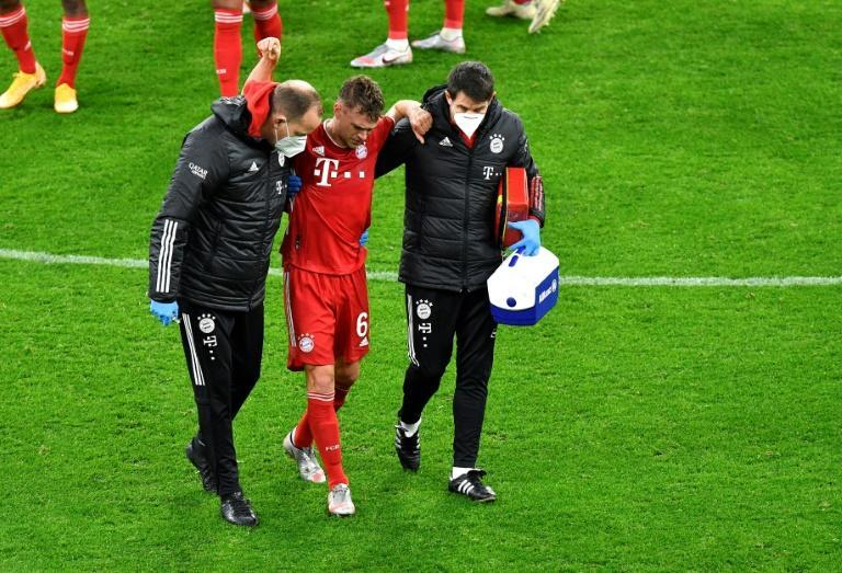 Injury to Germany midfielder Joshua Kimmich (C) cast a shadow over Bayern Munich's 3-2 win at Borussia Dortmund on Saturday