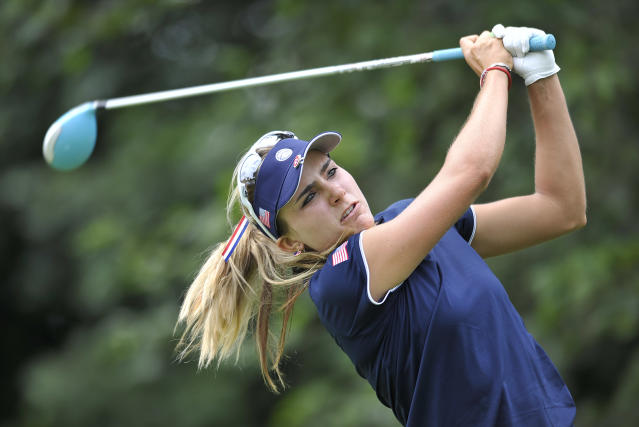 Lexi Thompson follows through on a drive on the seventh hole during the first round of the International Crown LPGA golf tournament Thursday, July 24, 2014, in Baltimore.(AP Photo/Gail Burton)