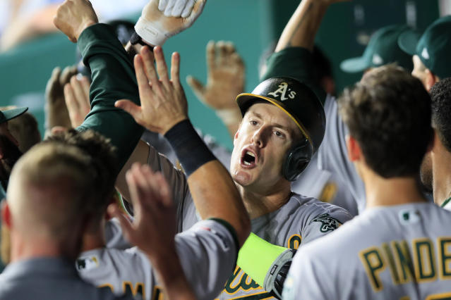 Oakland Athletics' Mark Canha celebrates his two-run home run during the fifth inning of the team's baseball game against the Kansas City Royals at Kauffman Stadium in Kansas City, Mo., Wednesday, Aug. 28, 2019. (AP Photo/Orlin Wagner)