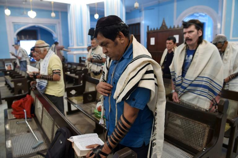 Members of India's tiny Jewish community pray at the Magen David Synagogue in Mumbai