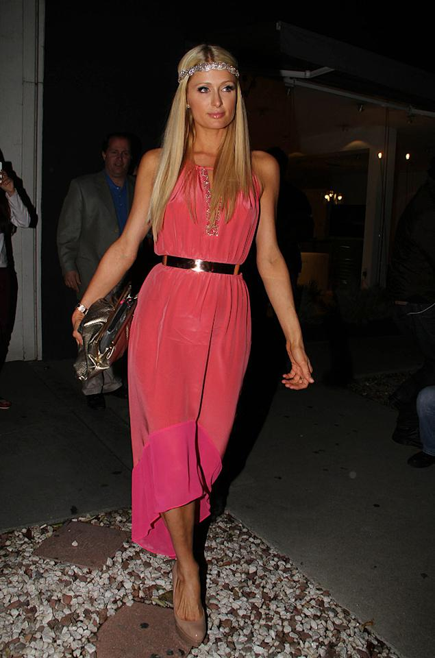 Paris Hilton knows how to make an exit and did just that as she departed the eatery with her pal Petra Ecclestone and six (yes, six!) bodyguards. And it was a good thing she had her army of protectors — last month a scuffle broke out between photographers, a Madeo employee, and some customers as the heiress left the restaurant with her sister. (4/12/2012)
