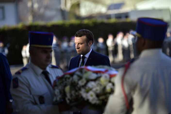 French President Emmanuel Macron lays a wreath of flowers as he pays tribute to French soldiers who died in Mali helicopter crash, Monday Jan.13, 2020 in Pau, southwestern France. France is preparing its military to better target Islamic extremists in a West African region that has seen a surge of deadly violence. (AP Photo/Alvaro Barrientos, Pool)