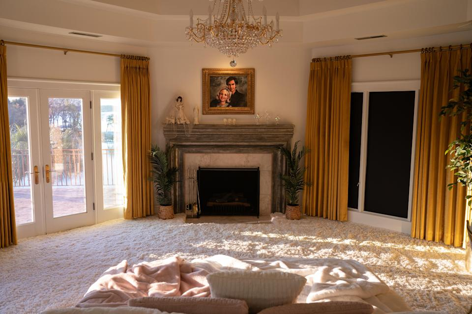 Tammy Faye's bedroom, where production designer Laura Fox placed the master bed in the center of the room - Credit: Daniel McFadden