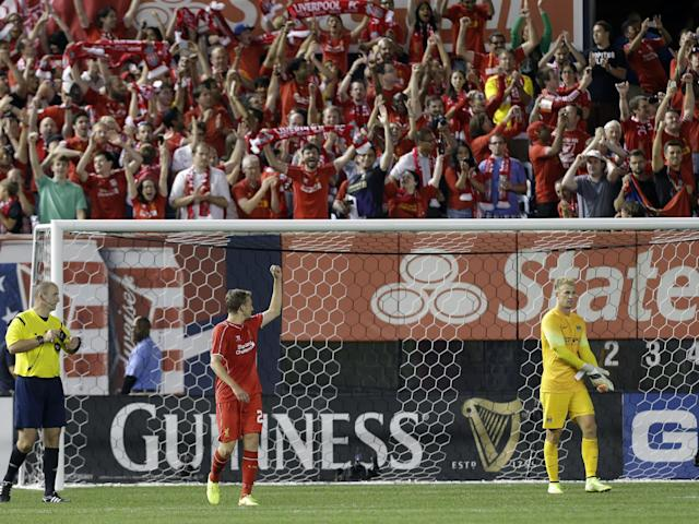 Liverpool's Lucas Leiva gestures to fans after scoring a goal on a penalty kick as Manchester City's Joe Hart (1) walks away after a Guinness International Champions Cup soccer tournament match Wednesday, July 30, 2014, in New York. Liverpool won the game 3-2 in a penalty kick shootout. (AP Photo/Frank Franklin II)