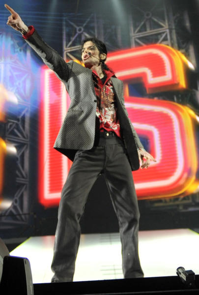 """** ALTERNATE CROP ** In this June 23, 2009 handout photo provided by AEG, pop star Michael Jackson rehearses at the Staples Center in Los Angeles. A doctor who treated Jackson on his 1993 """"Dangerous"""" tour testified on Monday, July 8, 2013, in a negligent hiring suit against AEG Live LLC that he expressed concerns that the singer had problems with prescription painkillers to a promoter who later became a top AEG Live executive. (AP Photo/Kevin Mazur, AEG/Getty Images) ** MANDATORY CREDIT. NO SALES, ARCHIVE OUT **"""