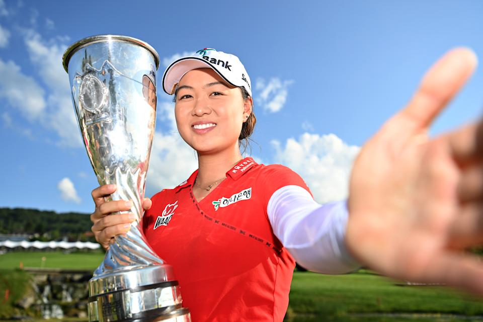 Seen here, Minjee poses with her first major golf trophy.