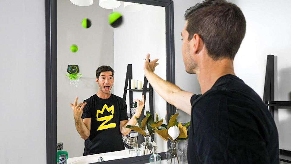 A trick shot using a mirror and twins.