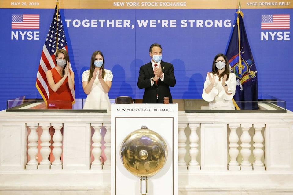 New York State Governor Andrew Cuomo, centre, applauds as he rings the opening bell of the New York Stock on May 26, 2020. Source: AP
