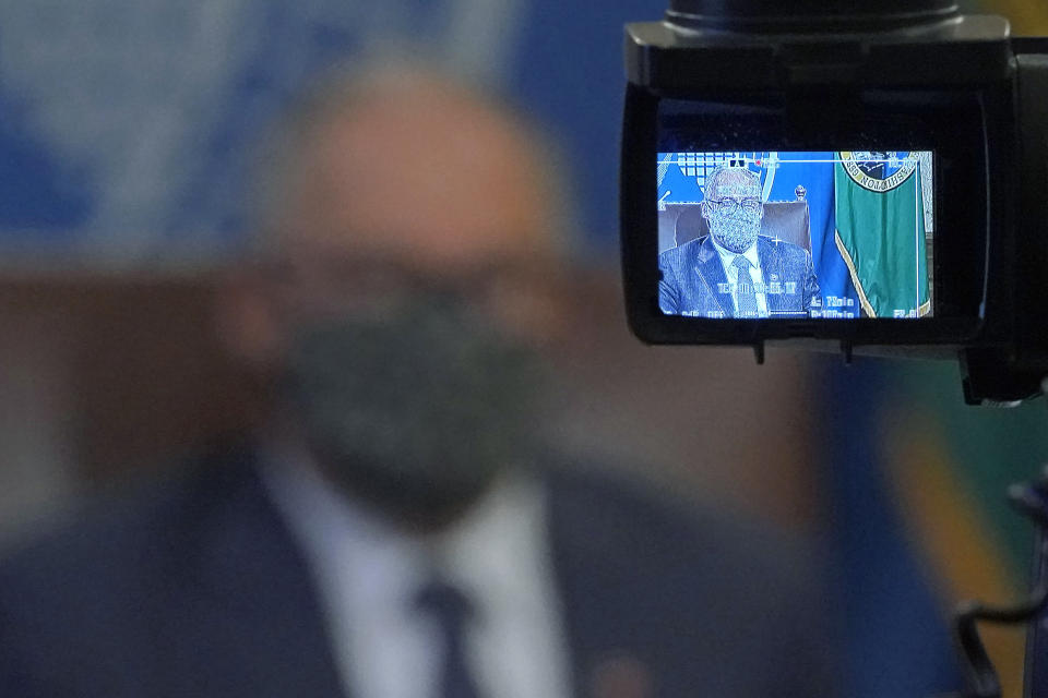 Washington Gov. Jay Inslee is shown on a TV camera viewfinder monitor as he speaks during a news conference, Sunday, Nov. 15, 2020, at the Capitol in Olympia, Wash. Inslee announced new restrictions on businesses and social gatherings for the next four weeks as the state continues to combat a rising number of coronavirus cases. (AP Photo/Ted S. Warren)