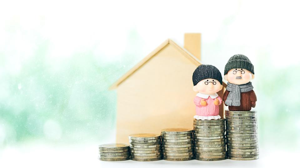 Retirement planning Concept of miniature old couple people figure standing on coin stack