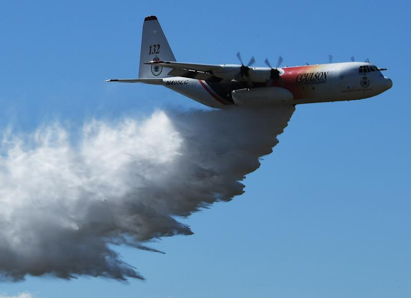 The US firefighters were flying a C-130 aircraft, similar to the one pictured, in southern NSW.