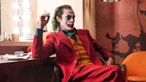 """What else is there to say about <em>Joker</em>? Joaquin Phoenix delivers a terrific performance as the Clown Prince of Crime and Todd Phillips makes Gotham probably as grimy as it has ever looked on the big screen. Oscars beckon and, despite what <a href=""""https://uk.movies.yahoo.com/todd-phillips-joker-sequel-094047006.html"""" data-ylk=""""slk:Phillips keeps saying;outcm:mb_qualified_link;_E:mb_qualified_link;ct:story;"""" class=""""link rapid-noclick-resp yahoo-link"""">Phillips keeps saying</a>, a sequel seems like a certainty. (Credit: Warner Bros)"""