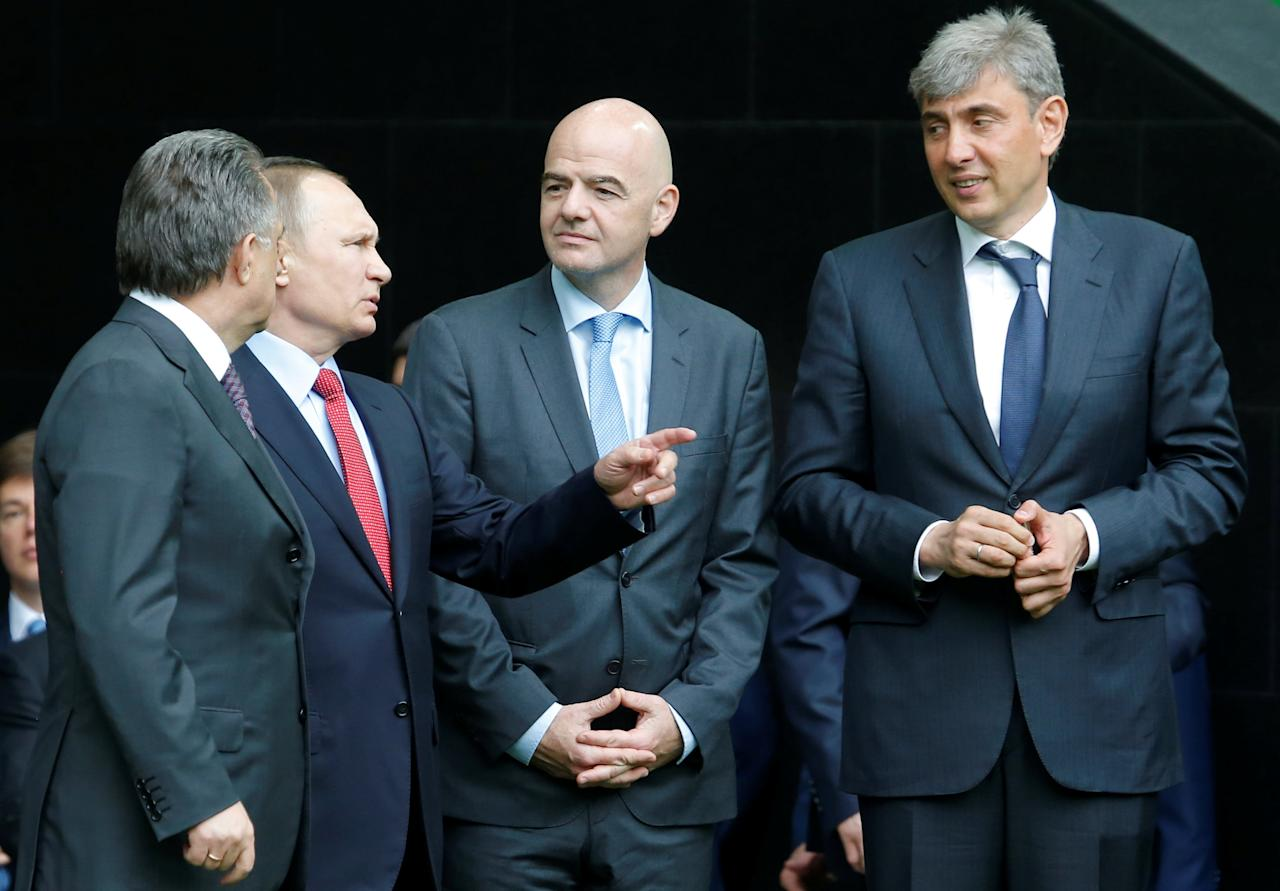 Russian President Vladimir Putin, Deputy Prime Minister Vitaly Mutko, FIFA President Gianni Infantino and Sergei Galitsky, the founder and Chief Executive Officer of Russia's food retailer Magnit, inspect the newly-built FC Krasnodar Stadium in the southern city of Krasnodar, Russia, May 23, 2017. REUTERS/Sergei Karpukhin